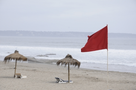 sunshade and red flag Stock Photo