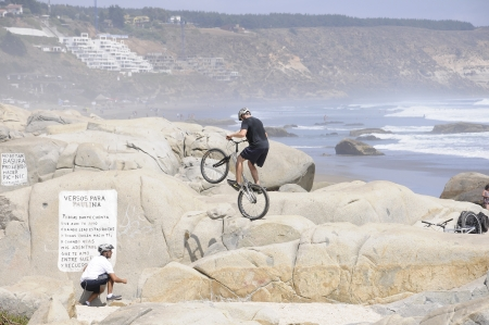 Cycling acrobatic on the rocks  Editorial