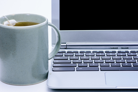right handed: Laptop with hot mug turned to wrong side