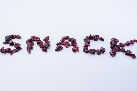 Snack spelled in dried cranberries with white space Banco de Imagens