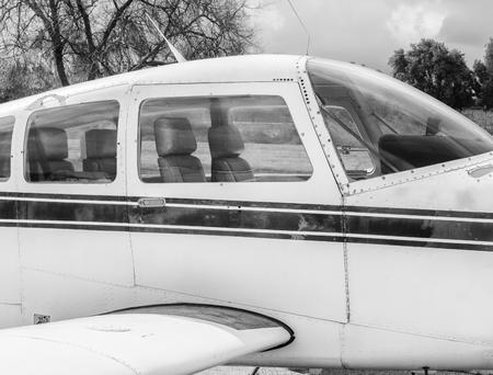 Black and white vintage plane seating area Фото со стока