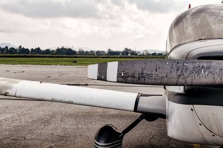 Propeller and wing of small plane at airport