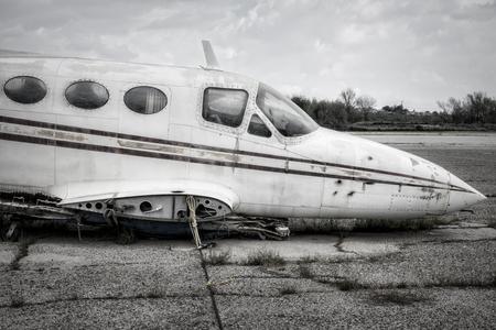 Broken plane sits on asphalt waiting for new wings