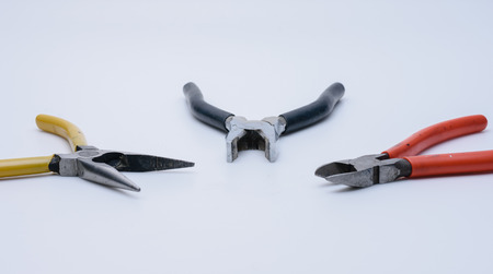 Three open pliers on white background