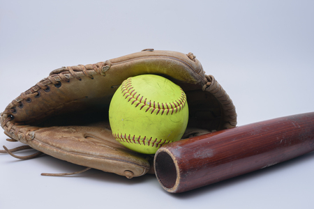 mitt: Ball inside of leather glove with wood bat