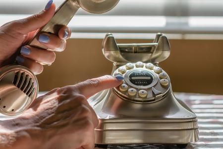 Female dialing phone