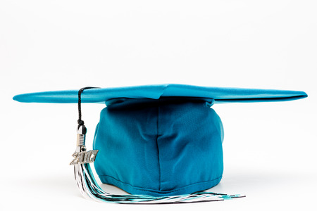 卒業の帽子とホワイト スペースとタッセル