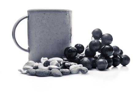 Coffee, tea, nuts, and fruit in black and white