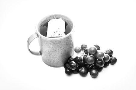 Black and white tea and fruit Stockfoto