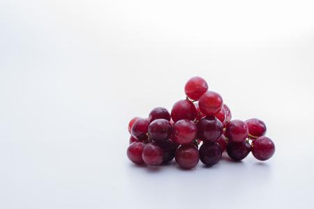 白い背景の赤ぶどう 写真素材
