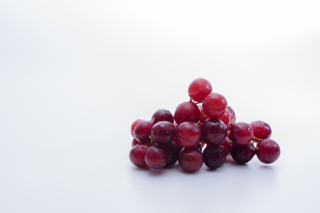 Red grapes with white background
