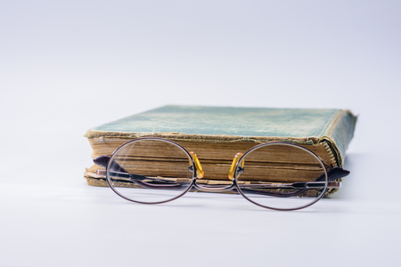 Looking through bifocals at vintage book Stockfoto
