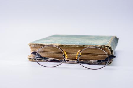 Looking through bifocals at vintage book Stock Photo