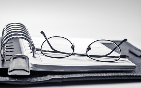 Black and white glasses and notebook