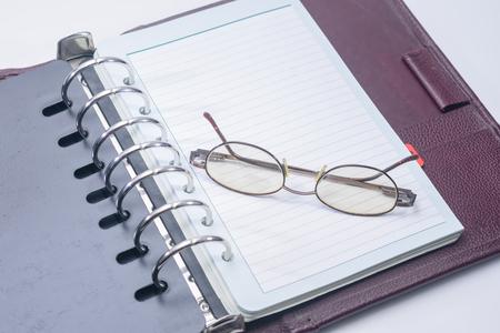 ビジネス ノートとグラス 写真素材