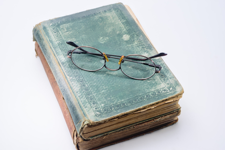Glasses for reading old textbooks Stockfoto