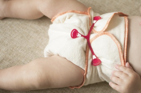 swaddling: Natural, fabric, reusable, cotton baby diaper, close-up Stock Photo