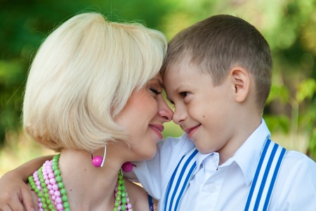Pictures of mother and son: happy son and mother hugging son  Stock Photo