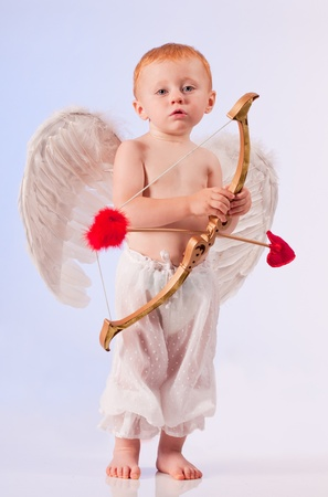 Baby cupid with arrow and bow photo