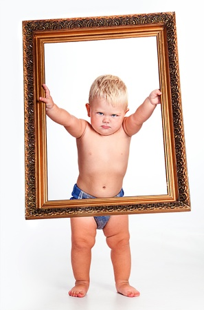 Portrait of a strict boy inwith picture frame