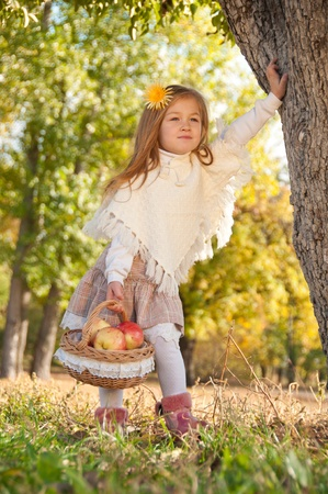 Beautiful little girl with a basket in anticipation