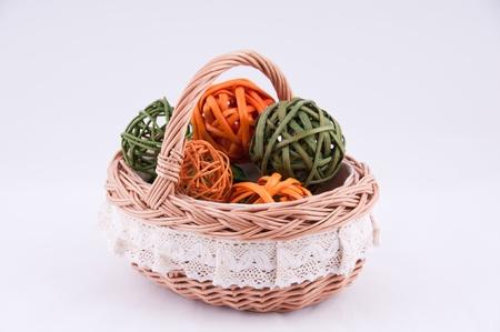 interleaved: Wicker basket on a grey background  Stock Photo