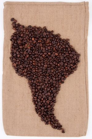 Coffee beans are laid out on the bag in the shape of South America  photo
