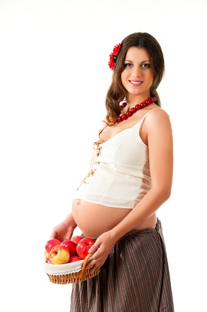 The image of a pregnant woman with a basket of apples