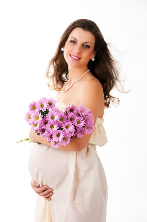The image of a pregnant woman with violet flowers isolated on white background Stock Photo - 12884143