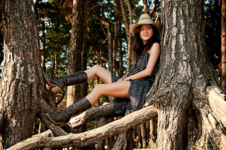 up country: A young girl in the style of the country against the backdrop of beautiful nature