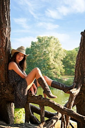 A young girl in the style of the country against the backdrop of beautiful nature