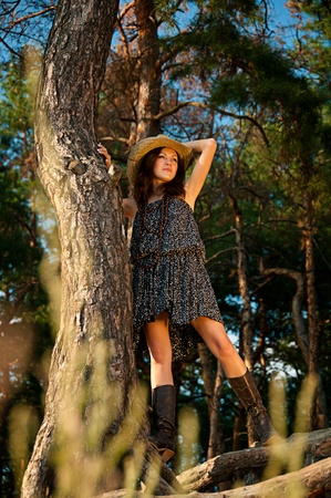 A young girl in the style of the country against the backdrop of beautiful nature  photo