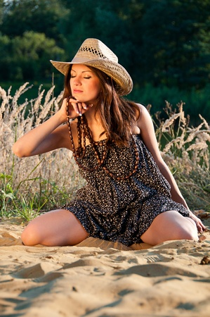 redneck: A young girl in the style of the country against the backdrop of beautiful nature