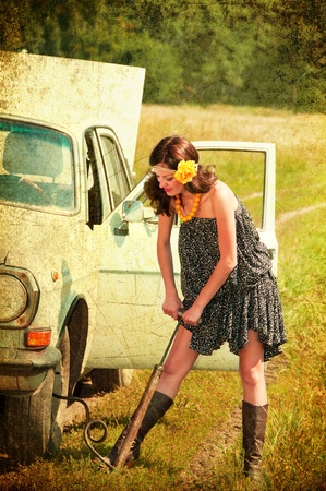 Beautiful brunette car repairs  Photos in the old style  photo
