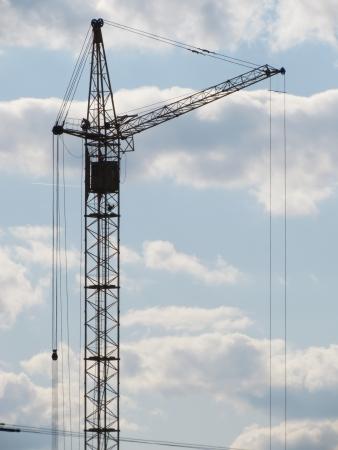 apartment shortage: Construction crane in the sky  Stock Photo