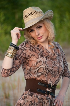 coquetry: Cute blonde girl in a cowboy hat  Stock Photo