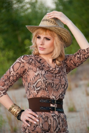 Cute blonde girl in a cowboy hat  Stock Photo