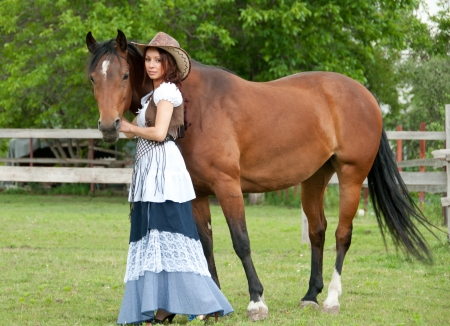 brown haired girl: A beautiful  girl in a cowboy hat with a horse