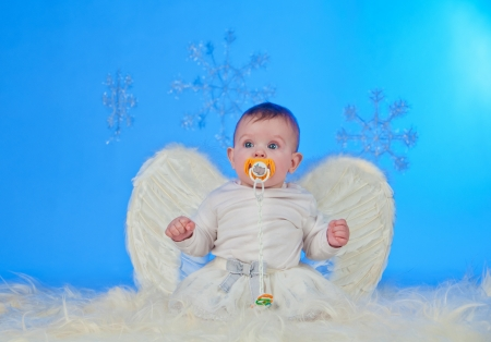Cute Christmas angel baby with angel wings photo