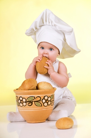Little cook  Cute  baby dressed in a chef photo