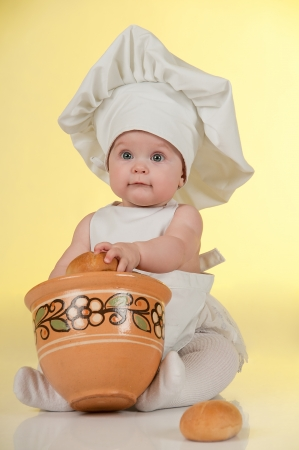 Little cook  Cute  baby dressed in a chef Stock Photo