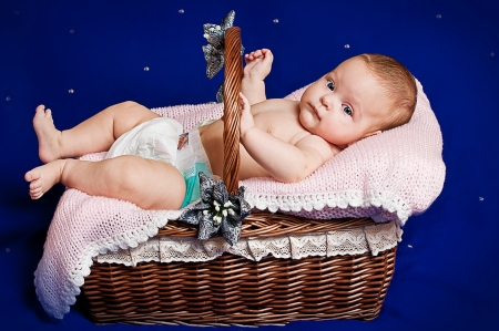 A small child lying in a basket  Stock Photo - 15469095