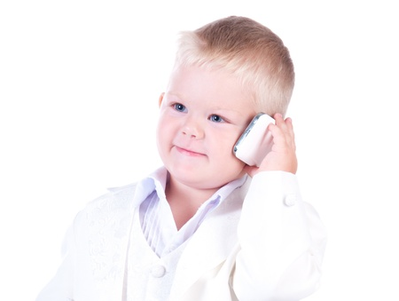 Little businessman in a business suit with phone in hand photo