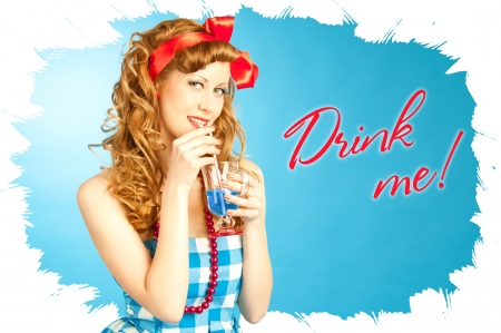 girl in red dress: Cute Lovely redhead pin-up girl drinks a drink from tube Stock Photo