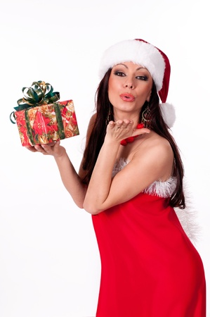 Beautiful brunette Santa Girl holding a gift box and sends a kiss Stock Photo - 16986737
