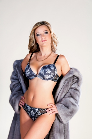 blue grey coat: Woman in lingerie and fur coat. The world of fashion, winter.