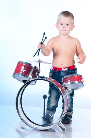 Cute boy playing the drums Stock Photo