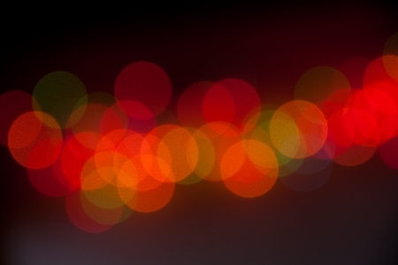 blur of lights, colorful bokeh circles on a dark background. Banco de Imagens