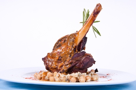Roast leg with vegetables in sauce  Stock Photo