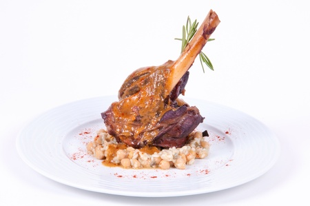 Roast leg with vegetables in sauce  Stockfoto